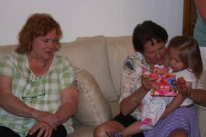 Grandmas helping open the last present